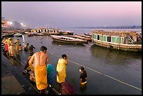 Ritual bath in the Ganga River at dawn. Varanasi, Uttar Pradesh, India (color)