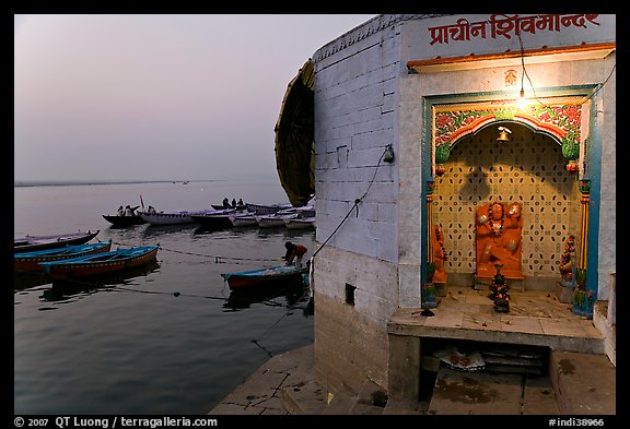 Shrine on the banks of the Ganges River at dawn. Varanasi, Uttar Pradesh, India (color)