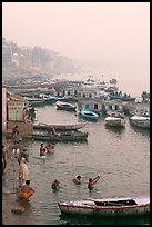 Pilgrims taking a holy dip in the Ganga River at dawn. Varanasi, Uttar Pradesh, India