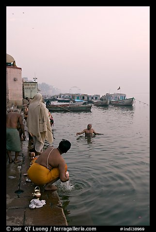 Hindu men dipping in the Ganges River at dawn. Varanasi, Uttar Pradesh, India (color)