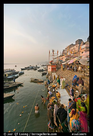 People worshipping Ganges River, early morning. Varanasi, Uttar Pradesh, India (color)