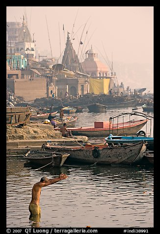 Man with arms stretched standing in Ganga River. Varanasi, Uttar Pradesh, India (color)