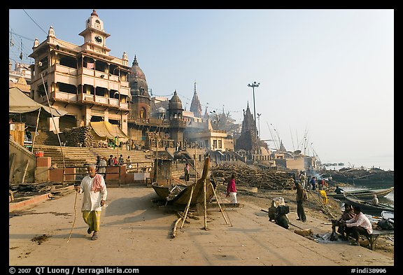 Manikarnika Ghat, with piles of wood used for cremation. Varanasi, Uttar Pradesh, India (color)