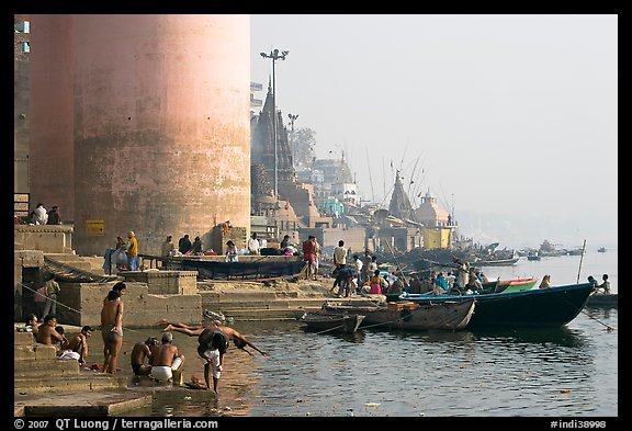 Ganges riverbank with men bathing. Varanasi, Uttar Pradesh, India (color)
