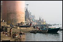 Ganges riverbank with men bathing. Varanasi, Uttar Pradesh, India