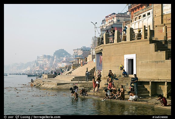 Men dipping in Ganga River at Meer Ghat. Varanasi, Uttar Pradesh, India (color)