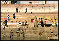 Men finishing their bath below the steps of Scindhia Ghat. Varanasi, Uttar Pradesh, India