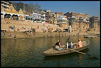 Rowboat in front of Scindhia Ghat. Varanasi, Uttar Pradesh, India ( color)