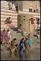 Women dipping feet in Ganga water at Sankatha Ghat. Varanasi, Uttar Pradesh, India