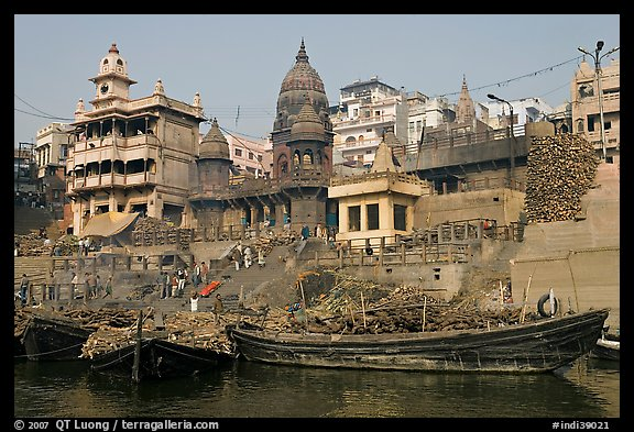 Huge piles of firewood stacked at Manikarnika Ghat. Varanasi, Uttar Pradesh, India (color)