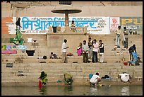 People washing cloths, steps, and Indi inscriptions. Varanasi, Uttar Pradesh, India