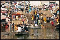 Boats and stone steps leading to Ganga River, Dasaswamedh Ghat. Varanasi, Uttar Pradesh, India