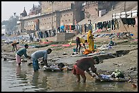 Men washing laundry on Ganga riverbanks. Varanasi, Uttar Pradesh, India