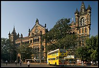 Yellow double-decker bus in front of Victoria Terminus. Mumbai, Maharashtra, India ( color)
