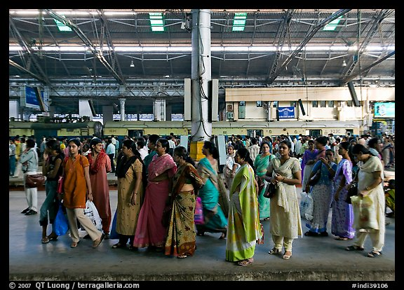 Women on train platform, Victoria Terminus. Mumbai, Maharashtra, India (color)