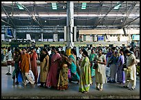 Women on train platform, Victoria Terminus. Mumbai, Maharashtra, India