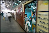 View of departing train with motion blur. Mumbai, Maharashtra, India (color)