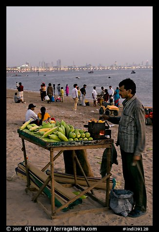 Food vendor on beach at dusk, Chowpatty Beach. Mumbai, Maharashtra, India (color)