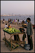 Food vendor on beach at dusk, Chowpatty Beach. Mumbai, Maharashtra, India ( color)