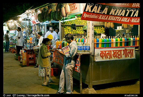 Drinks stall at night, Chowpatty Beach. Mumbai, Maharashtra, India (color)