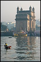 Small boat and Gateway of India, early morning. Mumbai, Maharashtra, India (color)