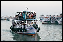 Tour boat loaded with passengers. Mumbai, Maharashtra, India (color)