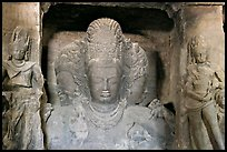 Trimurti flanked by pilasters with figures of dwarplalas, Elephanta caves. Mumbai, Maharashtra, India