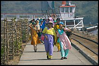 Women walking on  jetty, Elephanta Island. Mumbai, Maharashtra, India (color)
