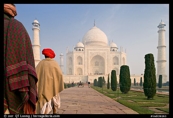 Men with turbans walking toward Taj Mahal, early morning. Agra, Uttar Pradesh, India (color)
