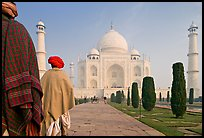 Men with turbans walking toward Taj Mahal, early morning. Agra, Uttar Pradesh, India ( color)