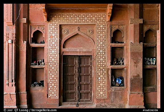 Wall with shoes stored, Dargah mosque. Fatehpur Sikri, Uttar Pradesh, India (color)