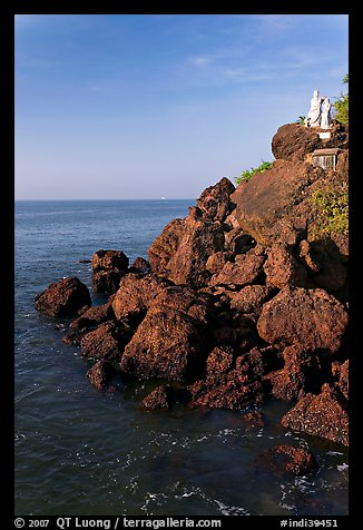 Boulders and christian statues overlooking ocean, Dona Paula. Goa, India (color)