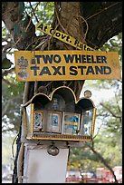 Two wheeler taxi stand and altar on tree. Goa, India (color)
