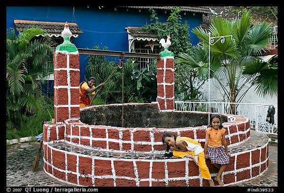 Woman and girls at communal well, Panjim. Goa, India (color)