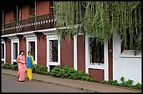 Women strolling past the heritage Panaji Inn, Panjim. Goa, India (color)