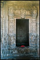 Inner sanctum with flowers and Vishnu image, Javari Temple, Eastern Group. Khajuraho, Madhya Pradesh, India (color)