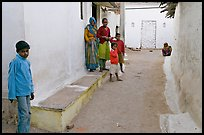 Family in village alley. Khajuraho, Madhya Pradesh, India (color)