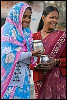 Women with pots used for religious offerings. Khajuraho, Madhya Pradesh, India