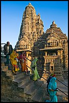 Worshipers going down stairs in front of Lakshmana temple. Khajuraho, Madhya Pradesh, India ( color)