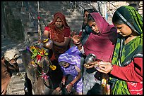 Women offering to an image at Matangesvara temple. Khajuraho, Madhya Pradesh, India (color)