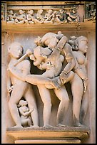 Erotic sculpture of couple in embrace, Lakshmana temple. Khajuraho, Madhya Pradesh, India (color)