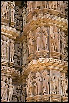 Sculptural details with apsaras, Kadariya-Mahadev temple. Khajuraho, Madhya Pradesh, India (color)