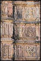 Carvings on the outside of Kadariya-Mahadeva temple including erotic figures. Khajuraho, Madhya Pradesh, India (color)