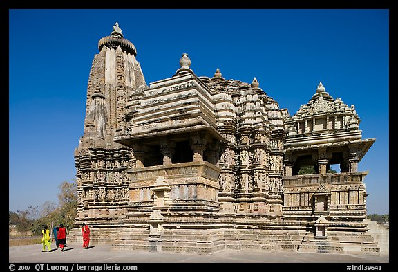 Devi Jagadamba temple with women walking. Khajuraho, Madhya Pradesh, India (color)