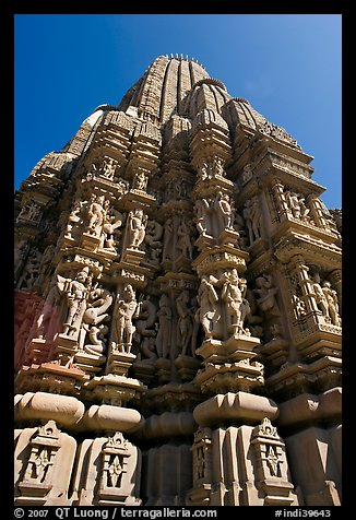 Sculptures and sikhara of Devi Jagadamba temple from below. Khajuraho, Madhya Pradesh, India (color)