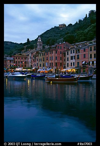 Yachts and fishing boats in Harbor at dusk, Portofino. Liguria, Italy (color)