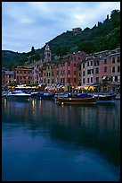 Yachts and fishing boats in Harbor at dusk, Portofino. Liguria, Italy
