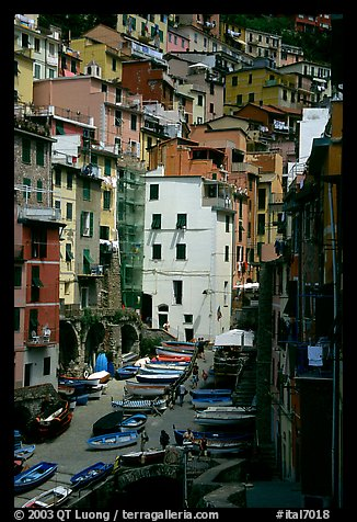 Plazza with parked boats built along steep ravine, Riomaggiore. Cinque Terre, Liguria, Italy
