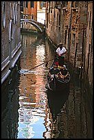 Gondola and reflections in a narrow canal. Venice, Veneto, Italy (color)