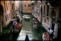 Busy water trafic in  narrow canal. Venice, Veneto, Italy
